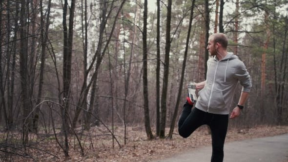 Thumbnail for Man Running In Forest Woods Training And Look At Smart Watches.