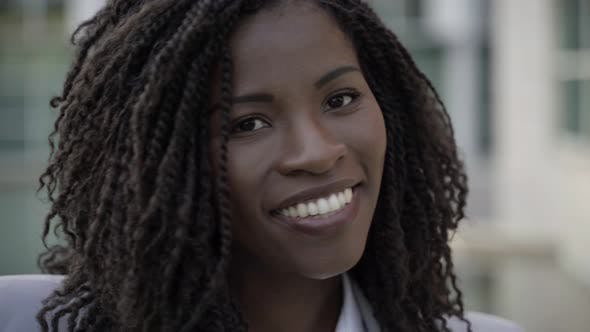 Thumbnail for Smiling African American Woman with Dreadlocks Looking at Camera