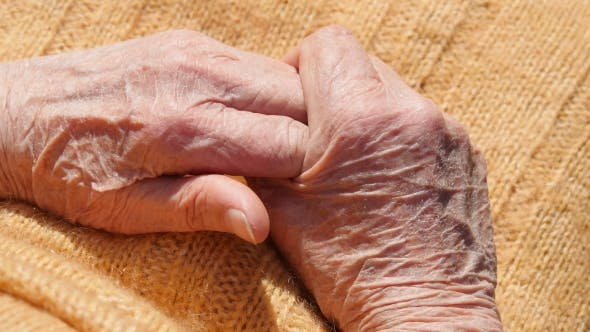 Thumbnail for Senior Woman Massages Painful Hands Outdoor