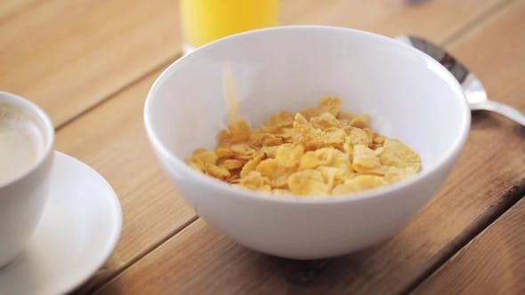 Thumbnail for Corn Flakes Pouring To Bowl And Coffee On Table 33