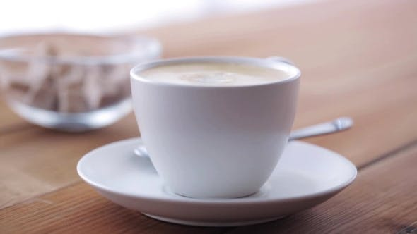 Thumbnail for Cream Pouring To Coffee Cup On Wooden Table 11