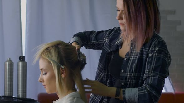 Thumbnail for In a Beauty Salon Eccentric Stylist Makes Professional Styling For The Girls. Hairstyle For Blonde