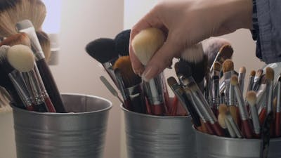 Set Of Cosmetic Brushes. Makeup Brushes In a Bucket