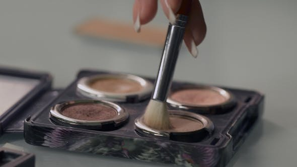 Thumbnail for Stylist Gaining Cosmetic Shadows On The Brush.
