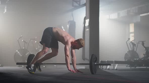 Fitness Man Doing Burpee Workout at Gym