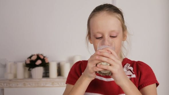 Thumbnail for Child Drinking Glass Of Milk