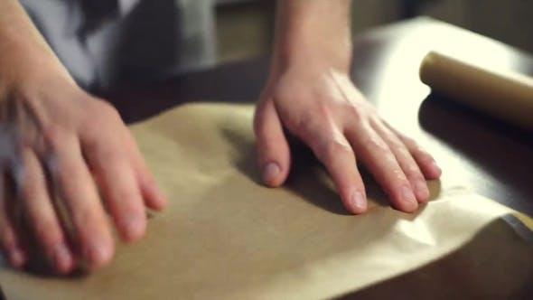 Preparing For Baking Cake. Cook Putting Baking Paper On Baking Pan