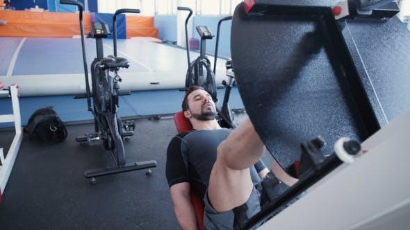 Thumbnail for Man Exercising On Leg Press Machine
