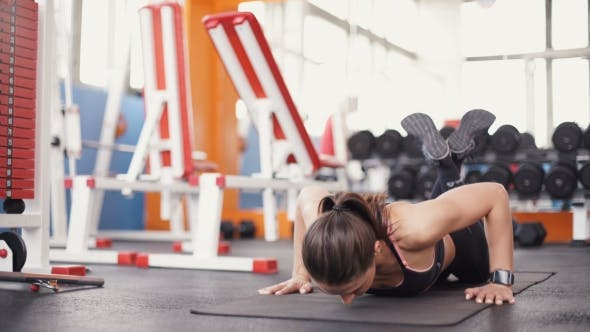 Thumbnail for Brunette Woman At Gym Push Up Workout Exercise