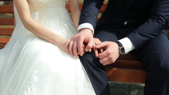 Thumbnail for The Bride And Groom Holding Hands