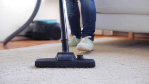 Thumbnail for Woman With Vacuum Cleaner Cleaning Carpet At Home 102