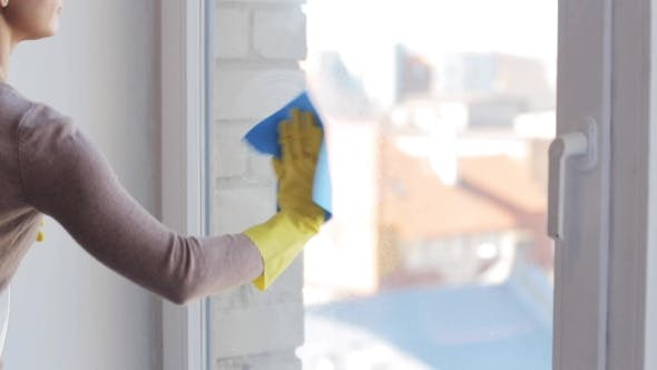 Thumbnail for Woman In Gloves Cleaning Window With Rag 18