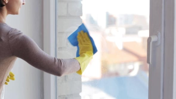 Thumbnail for Woman In Gloves Cleaning Window With Rag 19