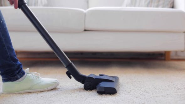 Thumbnail for Woman With Vacuum Cleaner Cleaning Carpet At Home 99