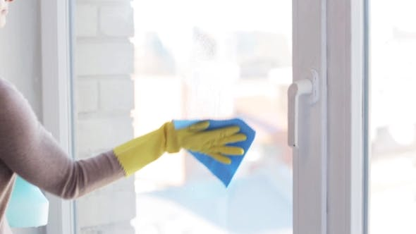 Thumbnail for Woman In Gloves Cleaning Window With Rag 14