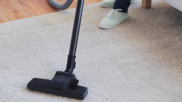 Thumbnail for Woman With Vacuum Cleaner Cleaning Carpet At Home 44