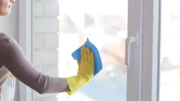 Thumbnail for Woman In Gloves Cleaning Window With Rag 15