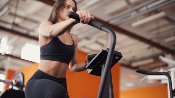 Thumbnail for Female On Gym Bike Doing Cardio Exercise