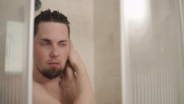 Thumbnail for Young Man Is Taking a Shower in Home in Morning Time, Close-up