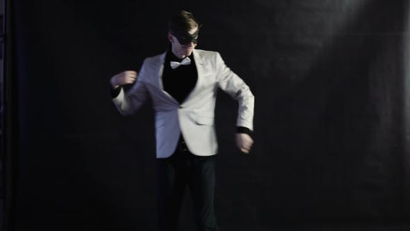 Thumbnail for Man Dances In a White Suit On a Black Background