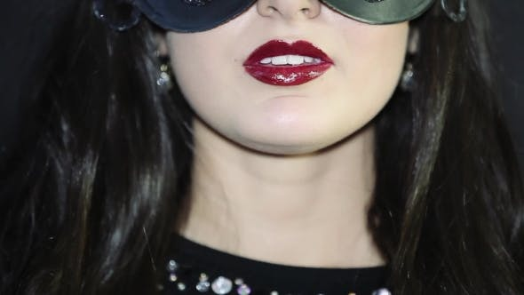 Thumbnail for Of Red Lips a Beautiful Girl In a Mask
