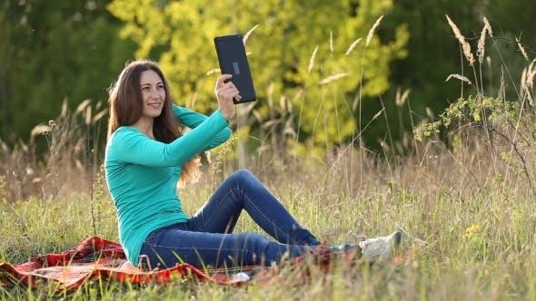 Thumbnail for Girl Doing Selfie Tablet