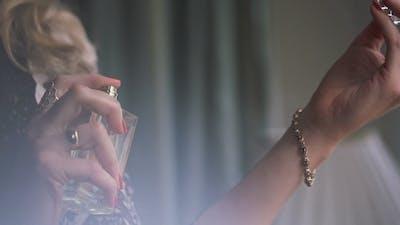Spraying Perfume On Hand
