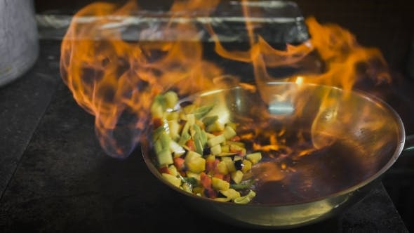 Thumbnail for Chef Frying Vegetables. Cognac is Ignited in the Pan. Open Fire in the Kitchen