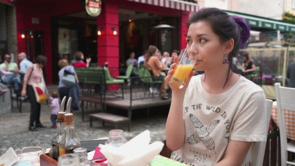 Thumbnail for Beautiful Woman Sitting In Outdoors Cafe At European City