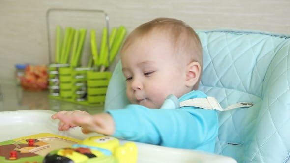 Thumbnail for Mother Spoon Feeding A Boy