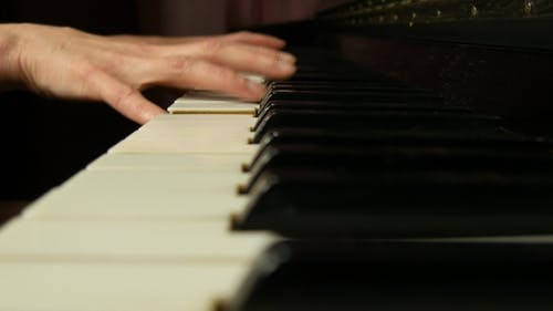 Female Hands Playing Classical Music On a Grand Piano