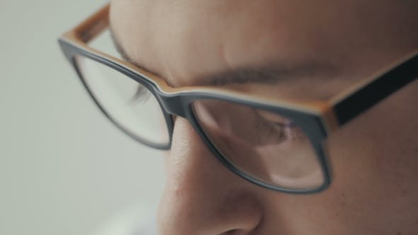Thumbnail for Portrait Of Young Business Man Wearing Eye Glasses With Glare Side View