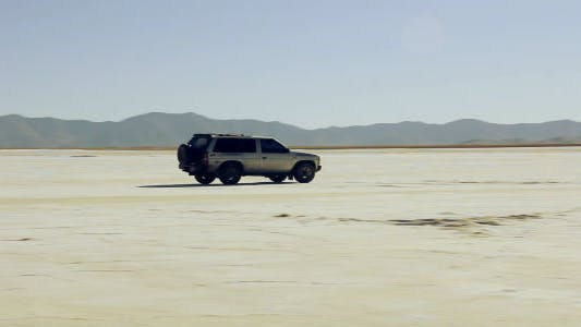 Thumbnail for Car Crossing a Salt Flat Desert.
