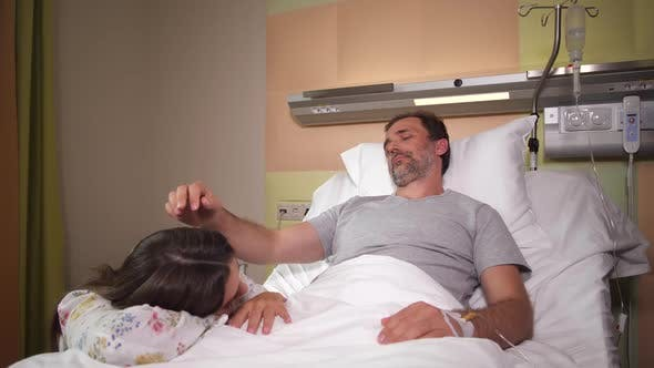 Thumbnail for Male Patting Beloved Wife Asleep at His Bedside