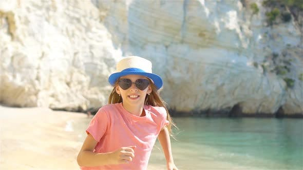 Thumbnail for Active Little Girl at Beach Having a Lot of Fun. Cute Kid Making Sporty Exercises on the Seashore