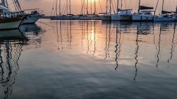 Thumbnail for Yachts Masts Reflection In The Sea Water Under The Twilight.