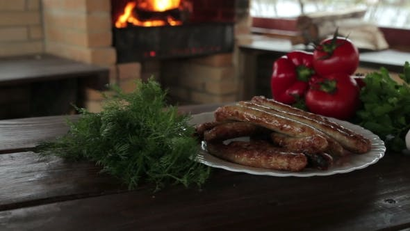 Thumbnail for Grilled Sausages on Charcoal