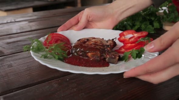 Thumbnail for Big Juicy Grilled Steak With Greens on the Plate