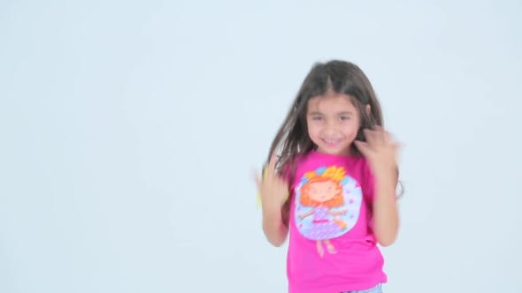 Thumbnail for Little Girl Having Fun And Dancing On a White Background