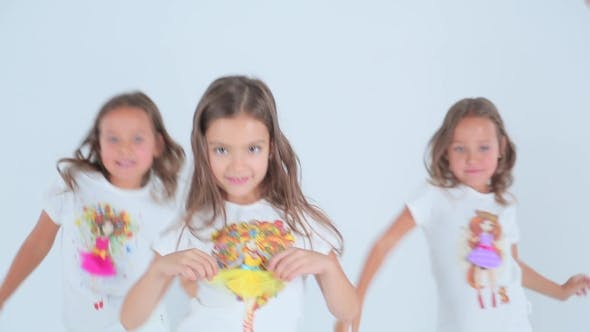 Thumbnail for Little Girls Having Fun And Dancing On a White Background