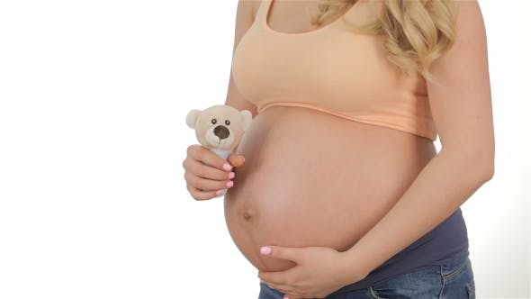 Thumbnail for Pregnant Blonde With Soft Toy