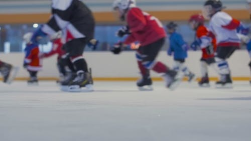 Young Hockey Players Cross The Ice Rink