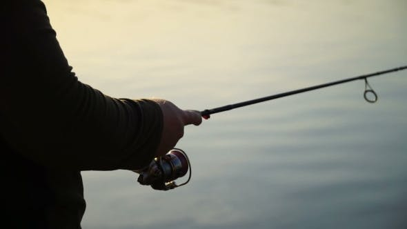 Thumbnail for Footage Fisherman Catching Predatory Fish With Spinning On The Lake.