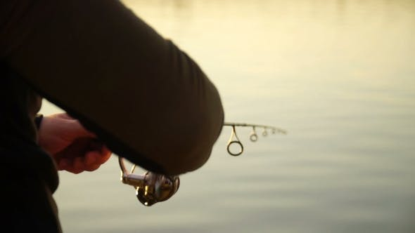 Thumbnail for Fisherman Catching Predatory Fish With Spinning on the Lake