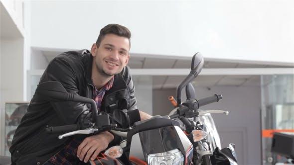 Thumbnail for Man Poses on Motorbike