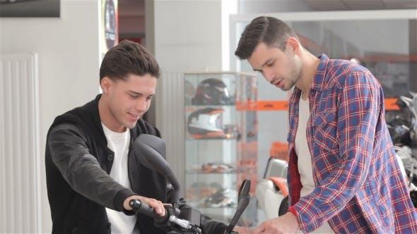 Thumbnail for Customer Sitting On Motorbike