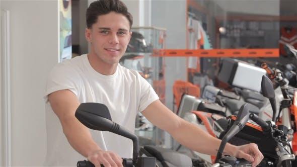 Thumbnail for Man On Motor Bike Smiles