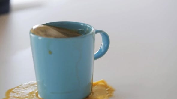 Thumbnail for Woman With Rag Cleaning Spilled Coffee On Table 12
