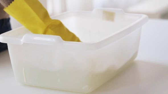 Thumbnail for Woman Washing And Squeezing Rag In Basin At Home 22