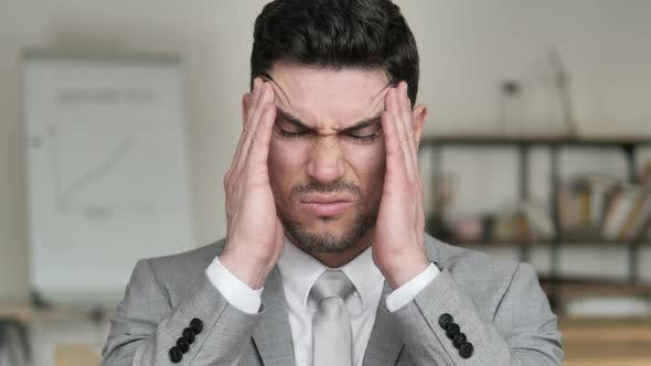 Thumbnail for Headache, Stressed Businessman with Pain in Head